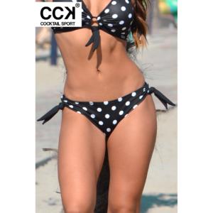 Fekete fehér pöttyös, hagyományos fazonú, megkötős bikini alsó